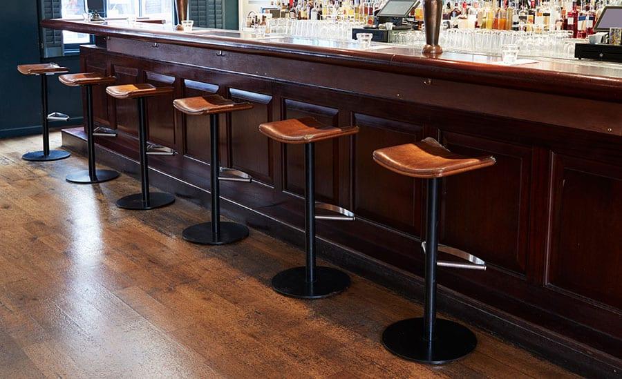 Why Bar Stools Don't Have Backs