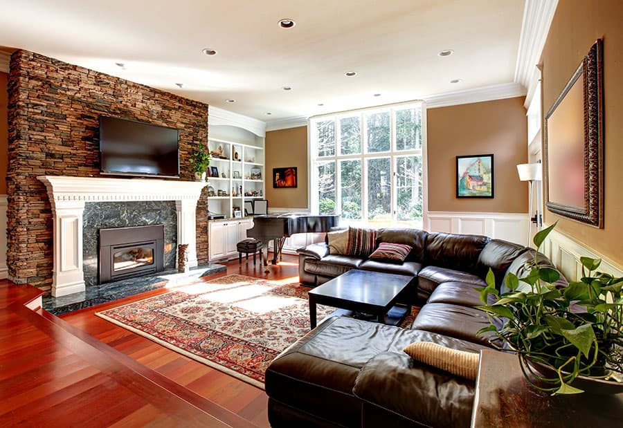 A Sectional Couch with A Fireplace